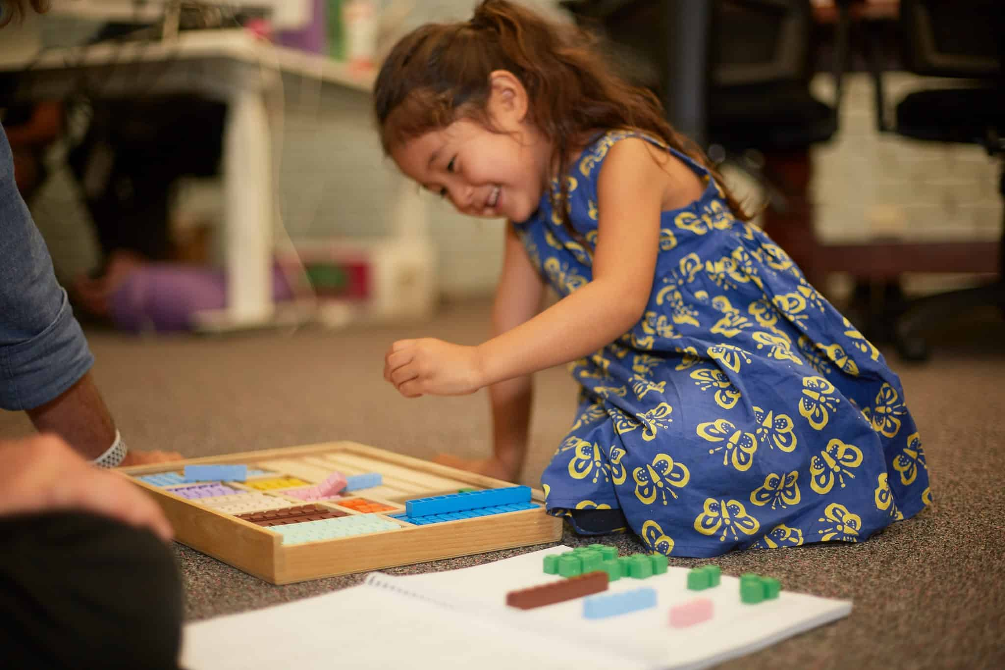 Child playing with blocks in the Primer Level