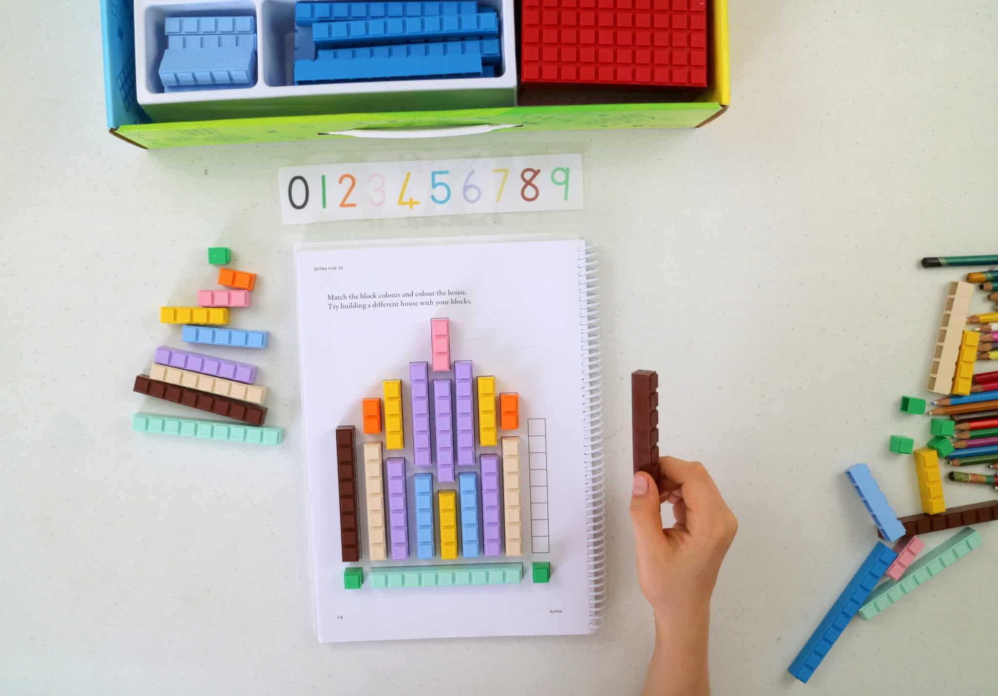 Child doing Math U see with integer blocks